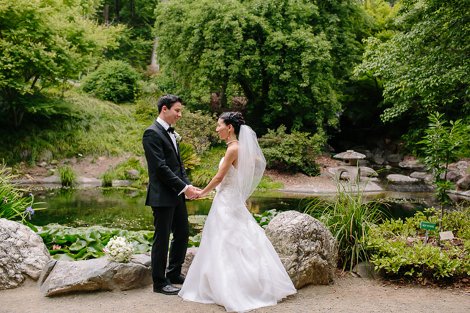 Bride and groom standing in front of the Japanese garden at the UC Berkeley Botanical garden