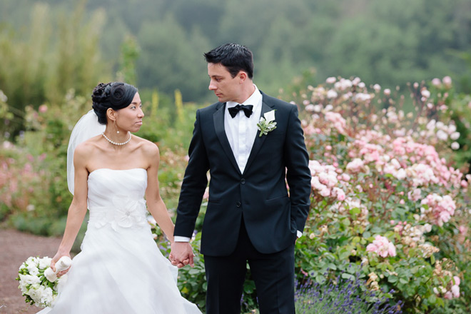 Bride and groom walking after their ceremony at their UC Berkeley Botanical Garden Wedding