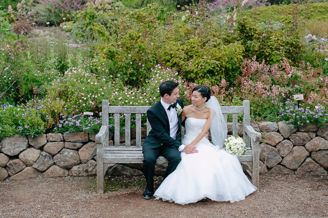 Bride and groom sitting on bench at their UC Berkeley Botanical Garden Wedding