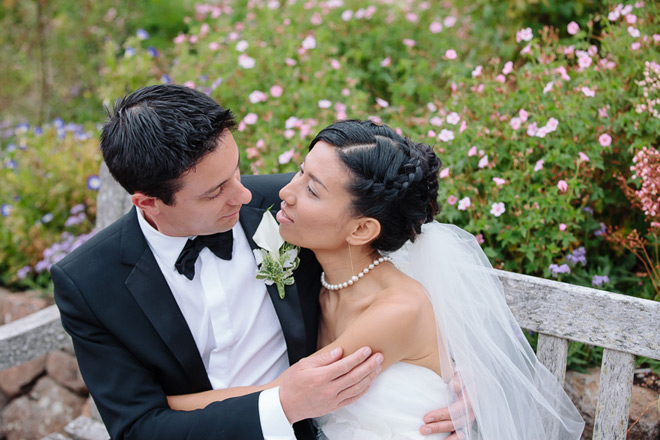 Bride and groom looking at each other after their ceremony at their UC Berkeley Botanical Garden Wedding