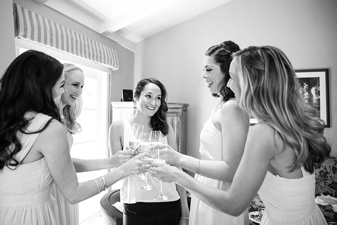 Bride and bridesmaids toasting at the Bernardus Lodge in Carmel