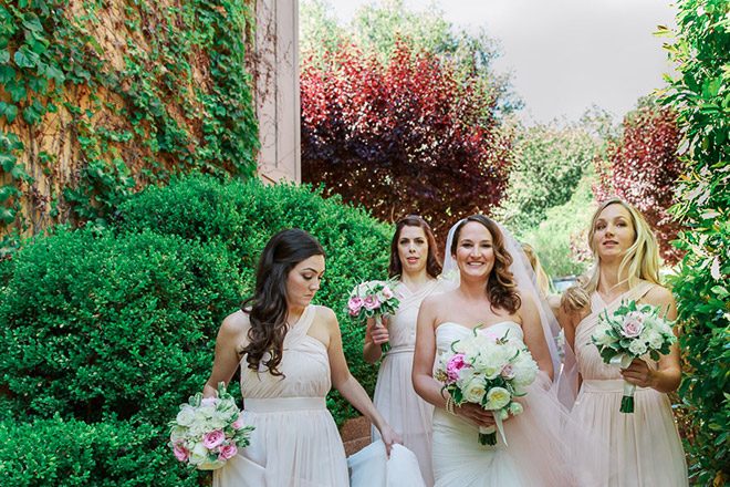 Bride and bridesmaids walking at the Bernardus Lodge in Carmel