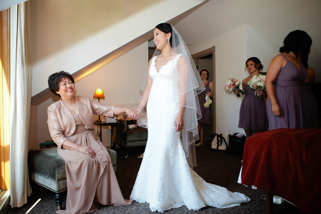 Bride holding hands with her mother