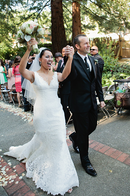 Bride and groom celebrate and walk down the aisle after their wedding ceremony at the Outdoor Art Club in Mill Valley