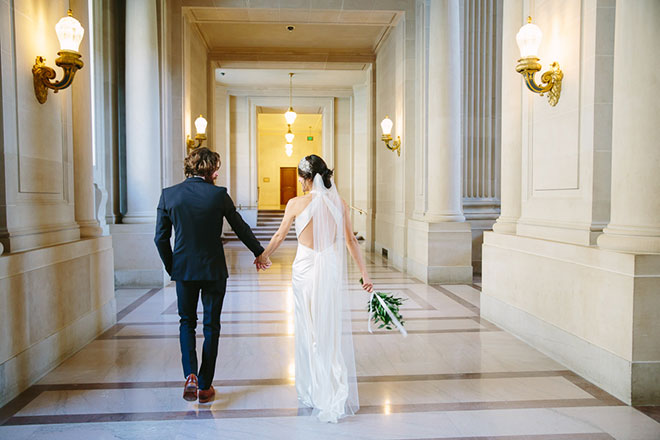 San Francisco City Hall wedding, Bride and groom walking to their ceremony