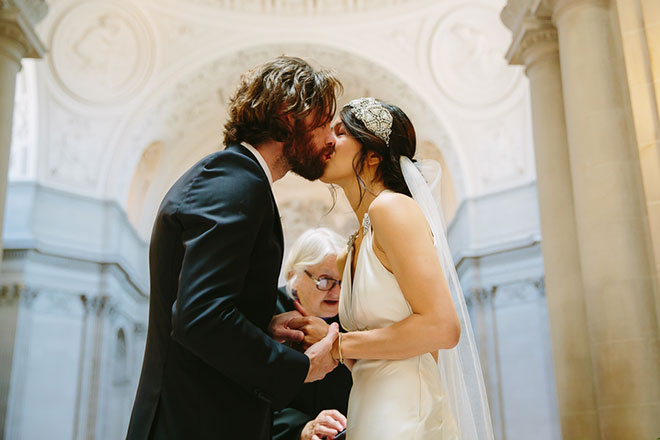 San Francisco City Hall wedding, Bride and groom kiss during their ceremony