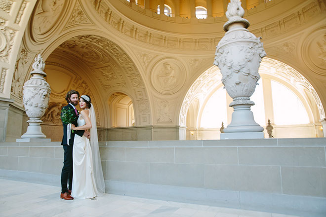 San Francisco City Hall wedding, Bride and groom standing together at their ceremony