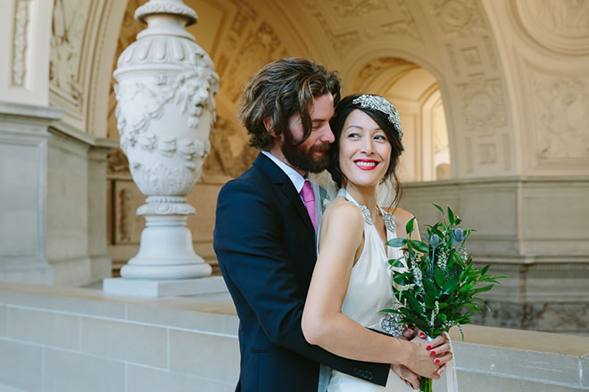 Groom holding his bride at their San Francisco City Hall wedding