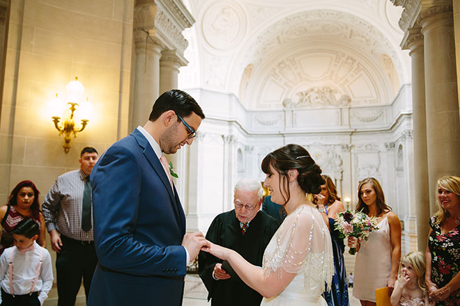 San Francisco wedding photographer, bride and groom saying their vows in the Rotunda during their San Francisco City Hall wedding ceremony