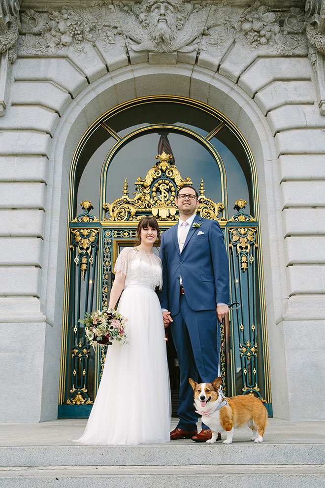 San Francisco wedding photographer, bride and groom with their dog on the steps of San Francisco City Hall