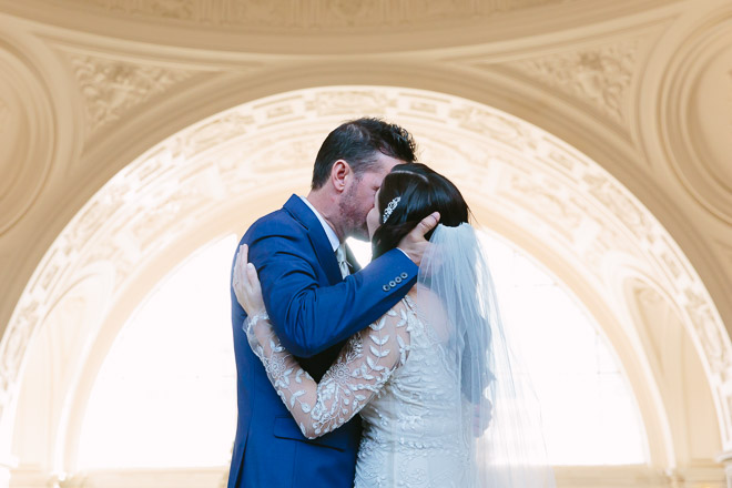 San Francisco wedding photographer, bride and groom kissing during their wedding ceremony at San Francisco City Hall