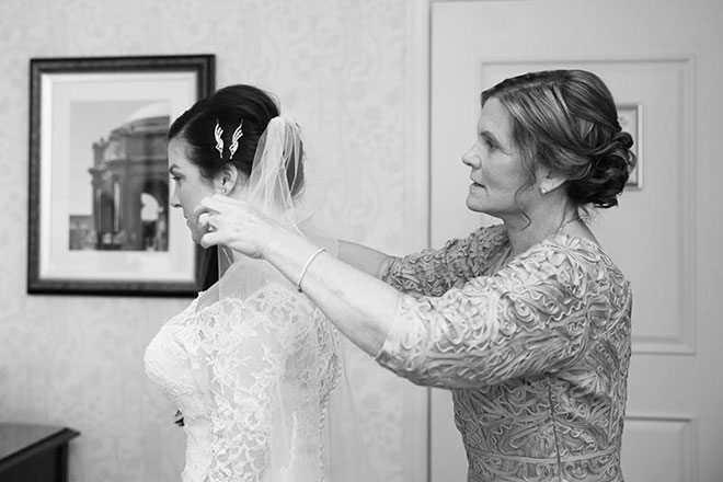 Mother of bride putting veil on her daughter in San Francisco