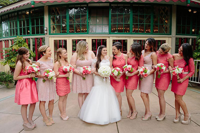 Bride and bridesmaids standing in front of the carousel at the San Francisco Zoo wedding