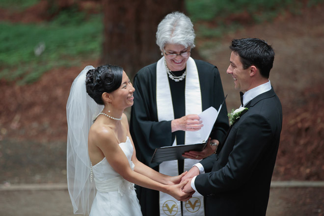Bride and groom laugh during their ceremony at the UC Berkeley Botanical Garden