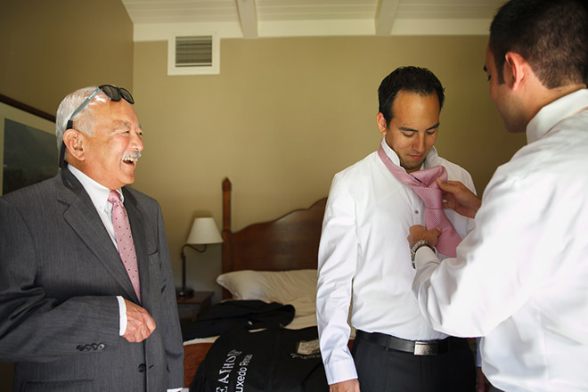 Groom with his brother and father helping him get ready at the Bernardus Lodge in Carmel