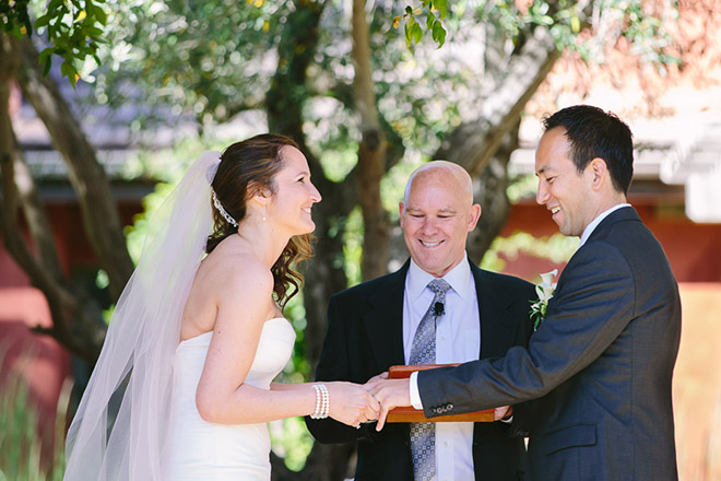 Bride and her sisters laughing during wedding ceremony at the Bernardus Lodge in Carmel