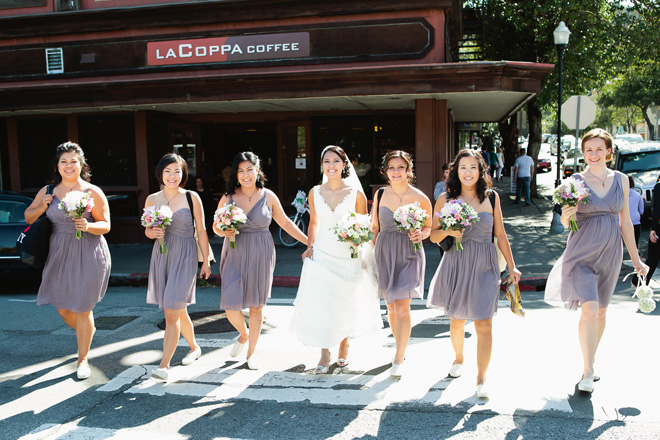 Bride and bridesmaids walking in downtown Mill Valley