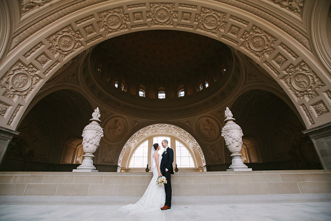 Couple standing on Fourth Floor of SF City Hall
