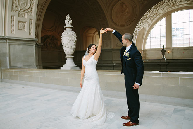 Just married couple dancing on Fourth Floor of San Francisco City Hall