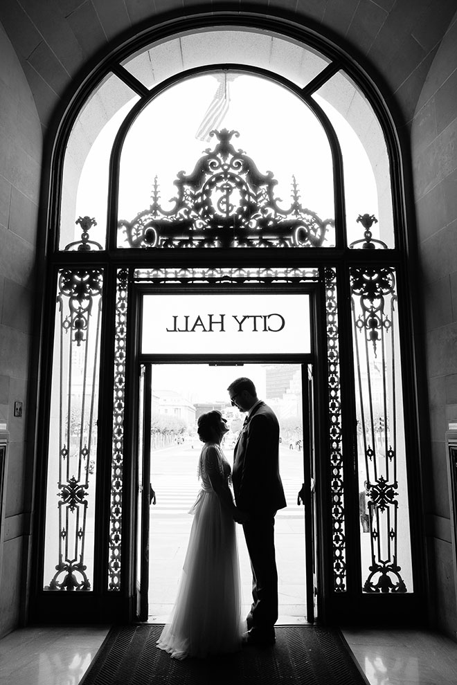 San Francisco wedding photographer, bride and groom silhouette at San Francisco City Hall