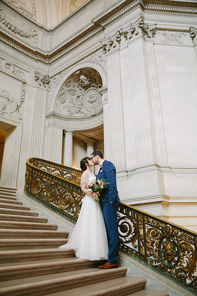 San Francisco wedding photographer, bride and groom on the Grand Staircase of San Francisco City Hall