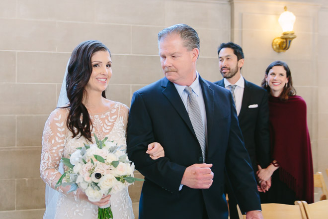 San Francisco wedding photographer, bride walking down the aisle with her father at San Francisco City Hall