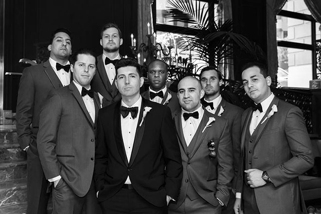 Groom and groomsmen standing in lobby of the Omni Hotel in San Francisco