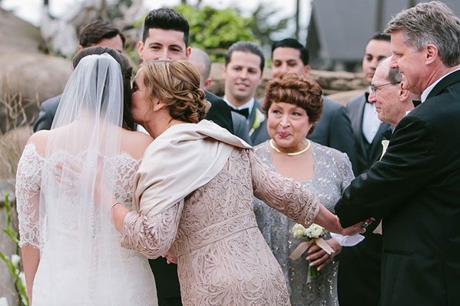 Mother kisses her daughter during ceremony at the San Francisco Zoo wedding