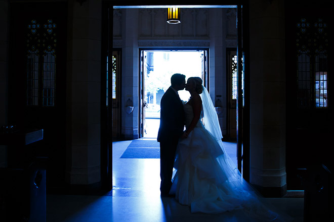 Bride and groom share a kiss at St. Dominic Church in San Francisco