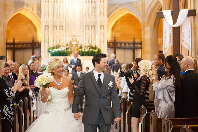 Bride and groom walking down the aisle at St Dominic Church in San Francisco