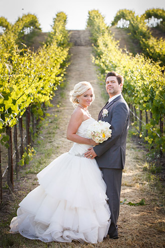 Bride and groom holding hands at their Sonoma wedding
